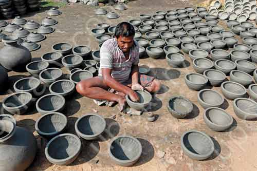 potter making pot