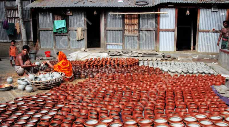 potter hourse yard with handmade pots