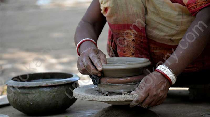 women making pot with soil